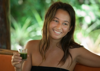 Body-Cleanse-participant-drinking-Glass-drink-smiling